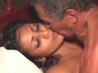 Old and young fuck scene focusing on a dark haired Indian bombshell