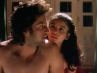 Wild haired stud being seduced by a skinny and skanky Bollywood beauty