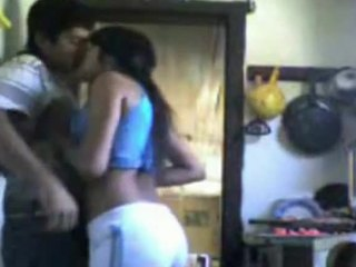 Frantic fuck scene featuring a young Indian couple in the kitchen