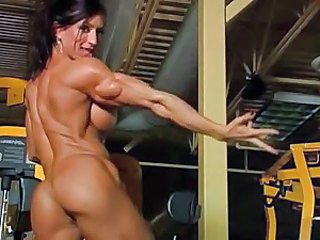 Incredibly muscular woman in gym totally nude