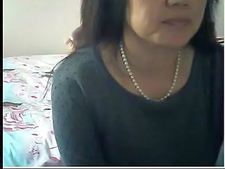 Chinese milf flashes tits
