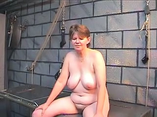 Old whore's filthy ass goes red from spiked glove spanking in dungeon