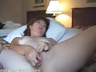 Sandra, 47 years married mom.  Alone coupled with home coupled with incredible horny after a webcam chat with a friend.  Rubbing my dildo with a lubricant. Toying my pussy, my asshole, massaging my clit coupled with property a s