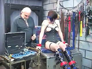 Cute tattooed bdsm brunette is hooked up to electricity torture device
