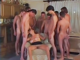 Busty Granny Gangbanged By 9 Lads
