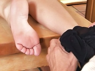 Superannuated guy and sweet chick's feet