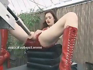 Kinky redhead vamp in leather red boots spreading wide her legs and pussy in masturbation