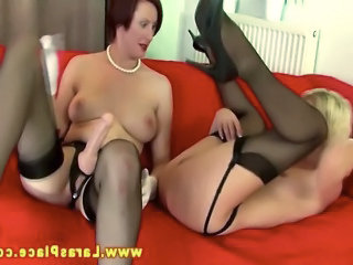 Mature lesbians loves strapon ass fucking on their couch HD