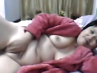 Fat Chinese Granny In A Red Bathrobe On Webcam Skype