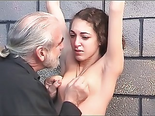 Cute dark haired girl gets restrained and tortured by her older BDSM master