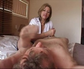 Hot MILF Milks Guy While He Smells Her Stocking Feet!