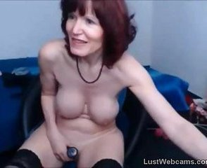 Busty mature dildoing her pussy on webcam