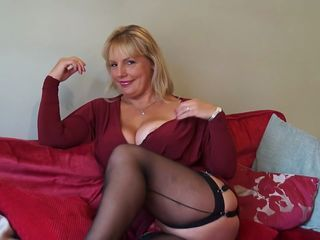 Huge titted blonde mom rubbing her pussy in stockings
