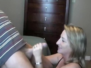 This lady loves to handle and suck her husband's cock.  She sucks it, puts on some flavored lube, and the strokes the shaft while she tonguing the tip in her mouth.  He finally cums in her mouth, moaning, and she swallows, with just a little bit of th