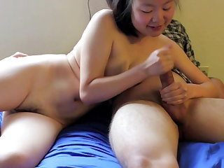 Korean Cum Whore, Justine Lim, Stroking a white Cock